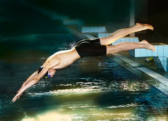 swimmer teen boy diving fish style