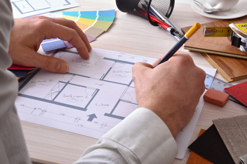 Designer developing a decoration project on your desk elevated v