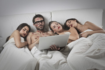 Man playing with laptop when the girls passed out