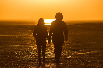 Happy valentine day two people silhouette sunset sea winter love