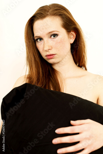 rothaarige junge frau im bett stock photo and royalty free images on pic 136974407. Black Bedroom Furniture Sets. Home Design Ideas