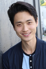 Young Asian male smiling and laughing