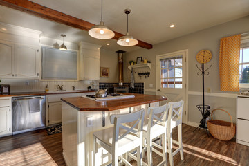 Newly renovated Kitchen boasts wood beams on ceiling