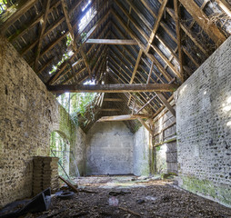 The interior of a dilapidated, collapsing old barn