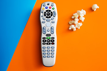 Tv cable remote and popcorn. Watching tv. Life style, entertainment, young people. fashion, design and interior concept