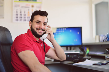 Man working in office at phone