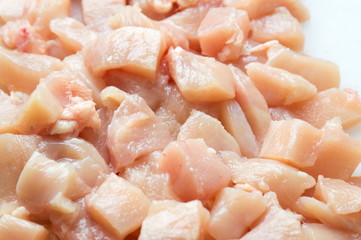 Raw chicken meat on a pile
