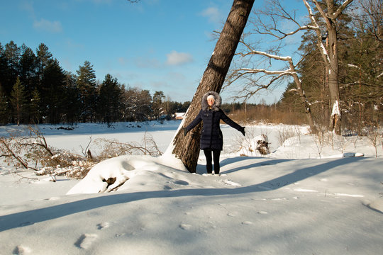 young woman snow winter pine forest