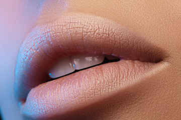 Sweet kiss. Perfect natural lip makeup. Close up macro photo with beautiful female mouth. Plump full lips