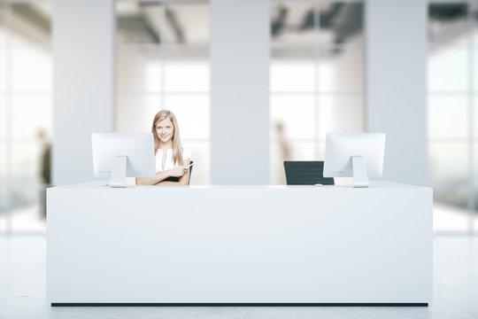 Woman at reception desk