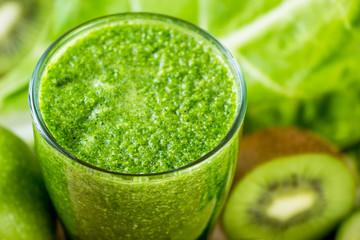 Green vegetable detox juice on wood table
