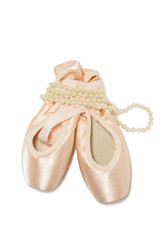Ballet points shoes isolated over white background with pearl