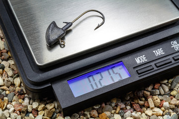 Jig head with pocket scale on the stony ground