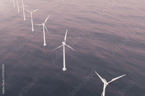 Offshore aerial view of wind turbines in the sea  Clean