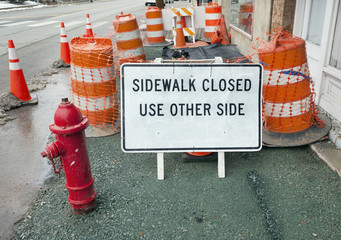 What a mess! SIDEWALK CLOSED. USE OTHER SIDE sign
