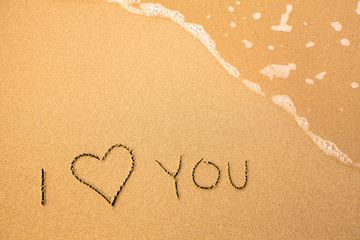 I Love You, text in the sea beach sand.