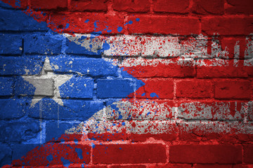 painted national flag of puerto rico on a brick wall