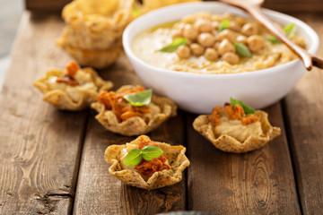 Homemade hummus in tortilla bowls