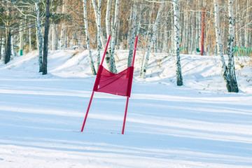 Slalom flag standing in the snow on the ski slopes