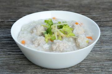 Traditional porridge rice with pork  in white bowl.