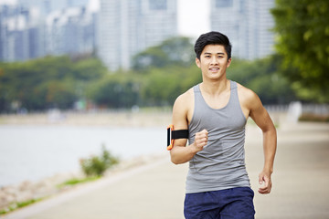 young asian jogger running in park