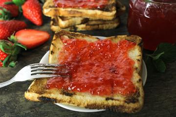 fresh strawberry jam on bread with fresh strawberry