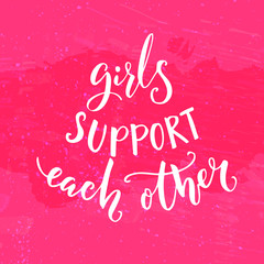 Girls support each other. Inspirational feminism quote. White modern lettering at pink background.