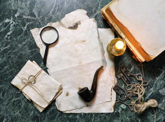retro papers and book on detective work table with tools