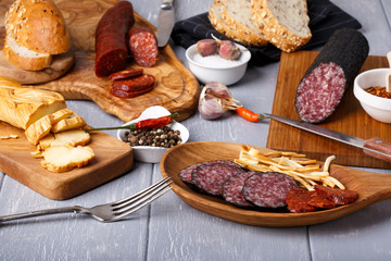 Variety of salami, cheese chechil and bread.