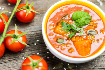 Vegetable Soup Detail with Cherry Tomatoes on Wooden Background