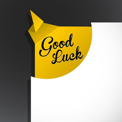 'Good Luck' text uncovered from torn paper corner.