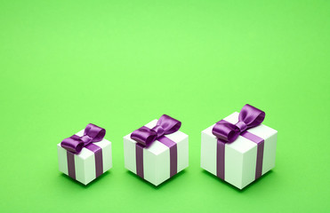 Gifts with satin bows on green
