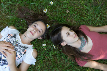 two sisters in the summer outside with flowers