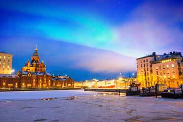 Foto auf Acrylglas Skandinavien Northern lights over the frozen Old Port in Katajanokka district with Uspenski Orthodox Cathedral in Helsinki, Finland