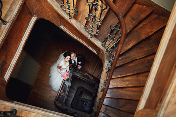 Beautiful young couple on stairs