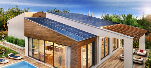 Modern House With Solar Panels On The Roof Stock Photo