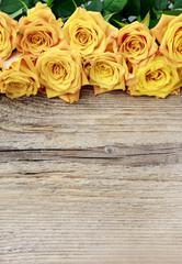 Wall Mural - Orange roses on wood