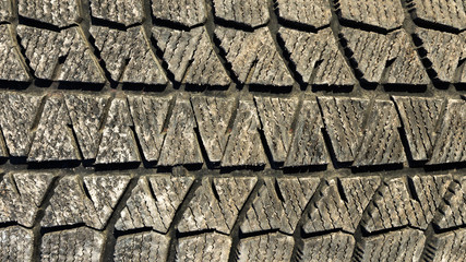 Dirty tyre tread close up