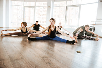 Group of people stretching and doing yoga exercises