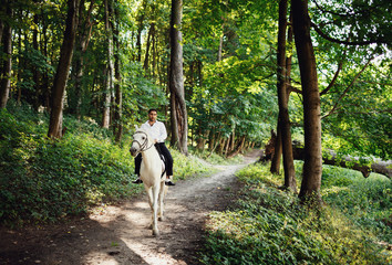 The groom riding a horse
