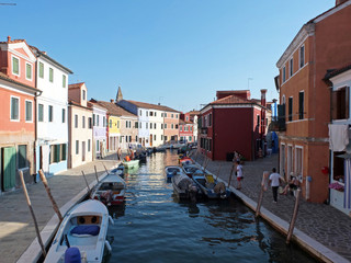 This photo shows one of the channels of the island Burano and multicolored houses in quays.