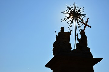 Silhouette of God the Father, Jesus Christ and Holy Spirit on The Holy Trinity column in Nova Bana, Slovakia