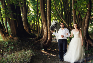 The brides walking with  horse