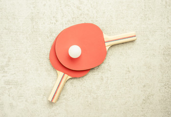 Ping pong or table tennis paddles and ball. Sport equipment with tabletennis rackets for leisure activity. Concept of game, recreation and playing ping-pong.