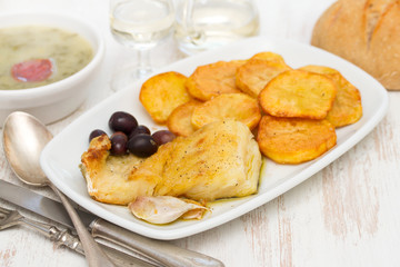 fried cod fish with potato on white dish