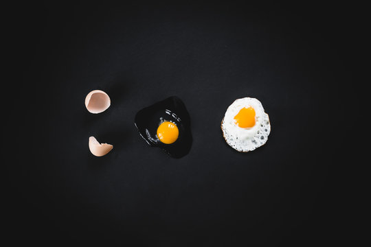 Raw broken egg and fried on a black background. Concept: from raw to finished process.