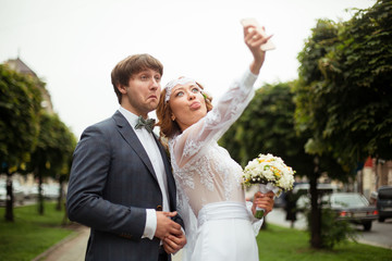 Happy stylish smiling couple walking and make selfy.