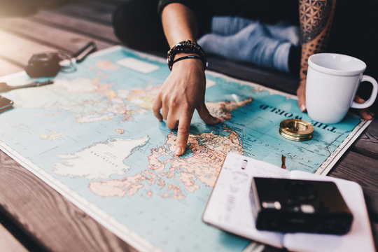 Tourist exploring the world map.