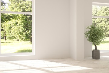 White empty room with green landscape in window. Scandinavian interior design
