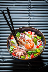 Tasty seafood noodle with prawn and octopus
